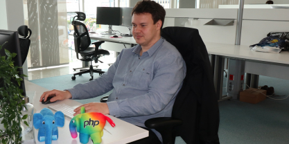 Peter, one of the release managers of PHP 7.4, working at his desk with elePHPant