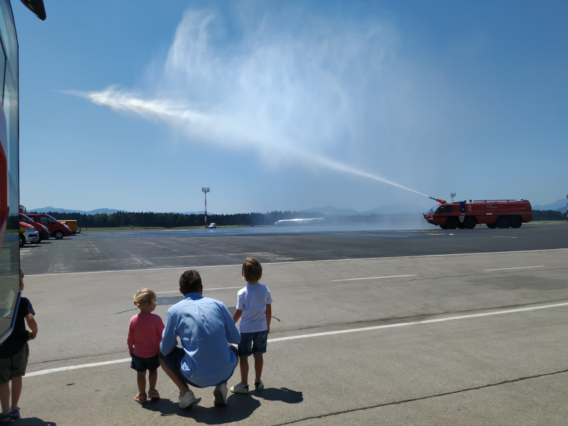 Marko and kids watching firetruck in action