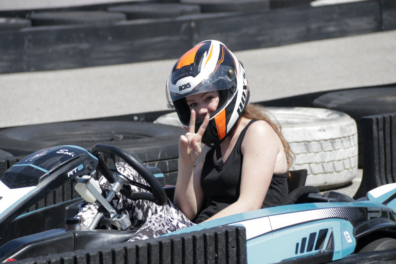 Branka in gokart giving peace sign with fingers