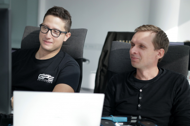 Developers Nik and Matija working in Celje office